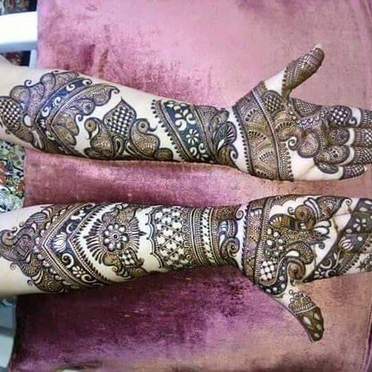 detailed mehandi art for bridals
