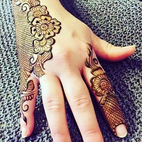 Traditional mehendi designs on back hand side