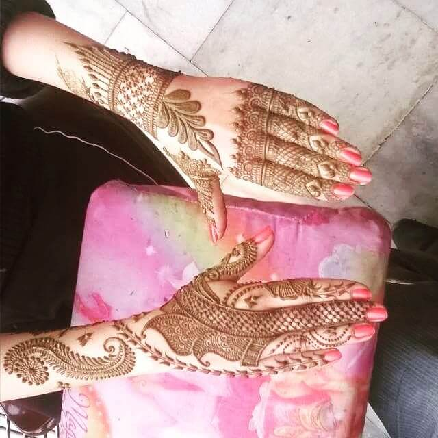 Backhand new and heavy mehndi designs 2018