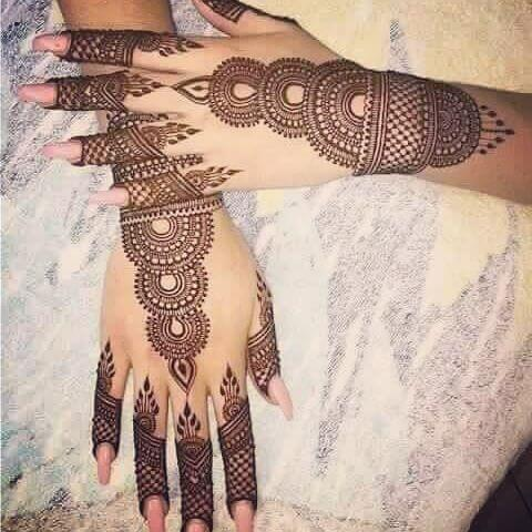 Backhand new and mehndi designs on Wedding