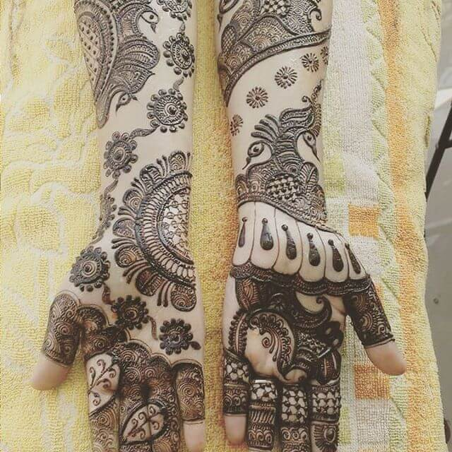 detailed mehandi art for bridals