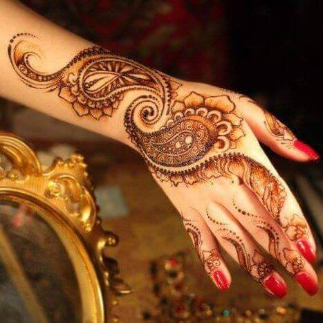 leafy mehndi art on backhand