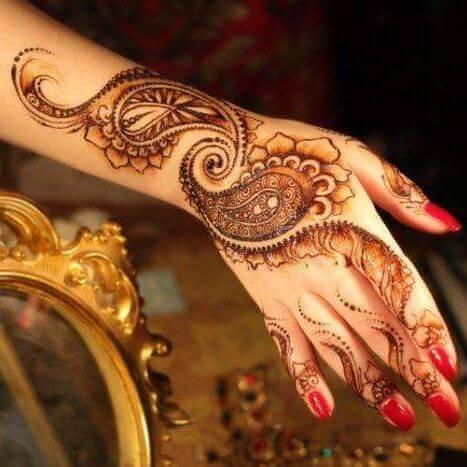 leafy mehndi art on backhand