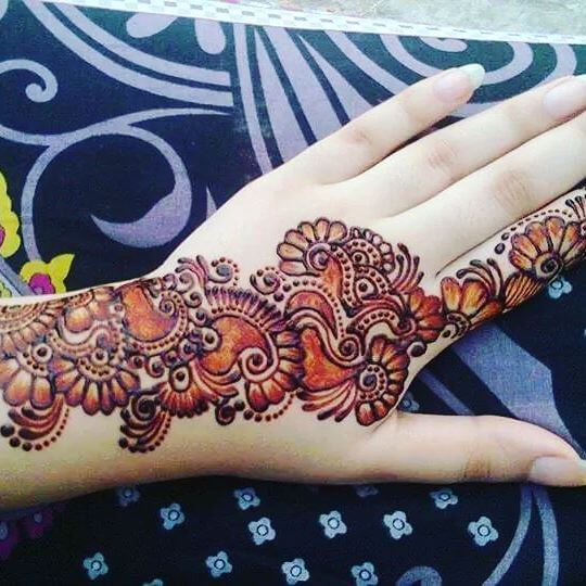 beautiful hands with elegant mehndi