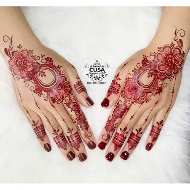red glitter mehndi on hands
