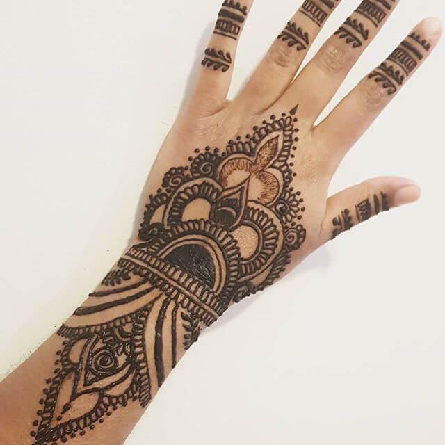 back hand v shaped mehndi design