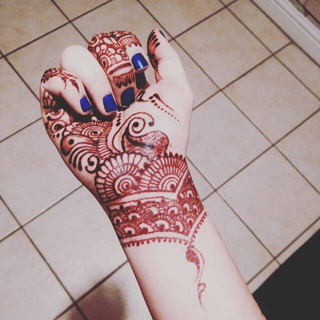 Purple Henna design for front hands