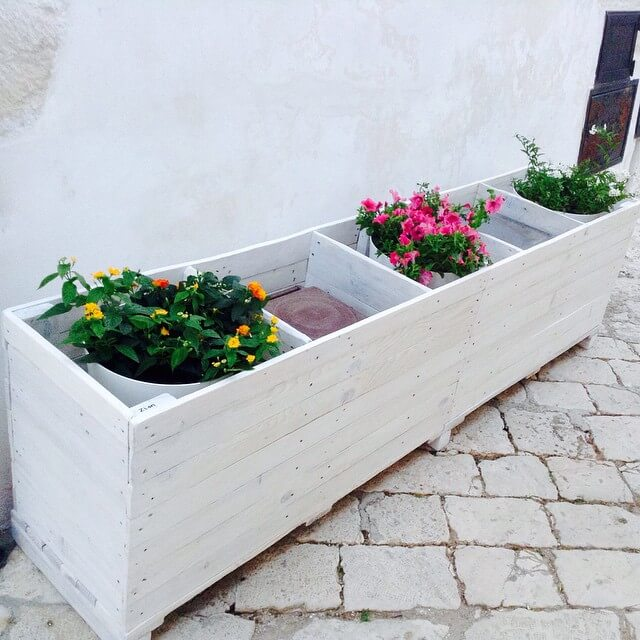 A paired whitish Pallet planter for the garden