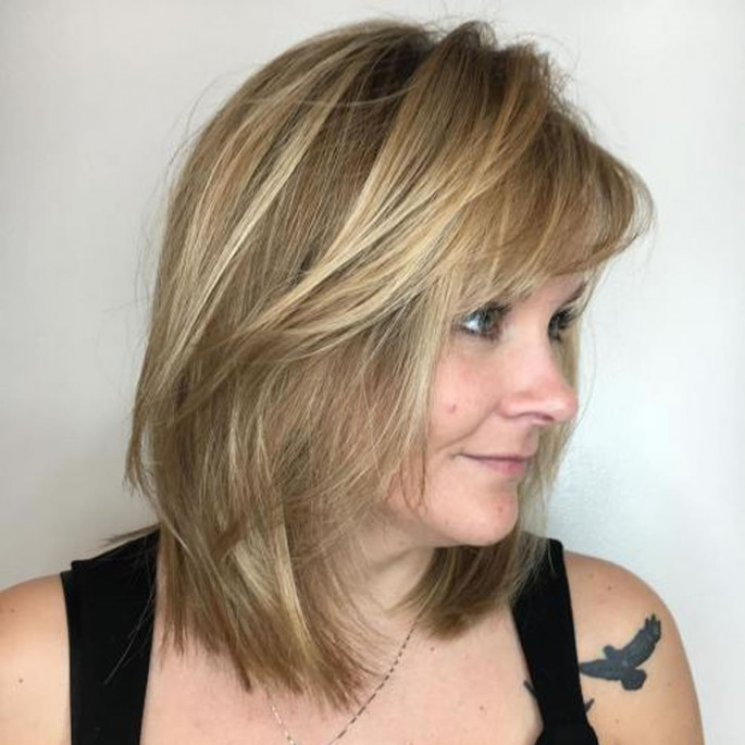 Mid-Length Hairdo with Bangs for Older Women