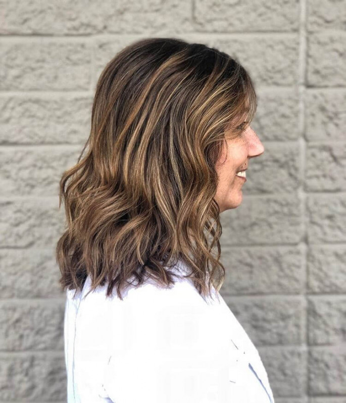 Loose Waves with Bangs Hairstyle for Medium Length