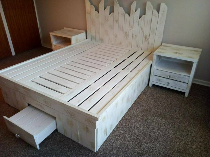 wooden pallet bed frame with storage boxes and side Table
