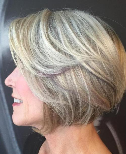 Medium White Blonde Feathered Hairstyles for Older Women
