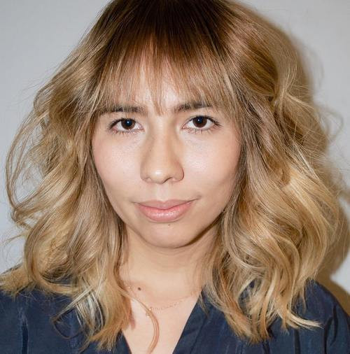 Top-Knot with Bangs Hairstyle
