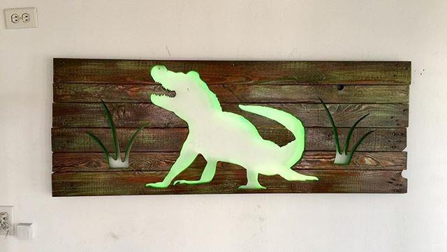 Pallet glowing crocodile art