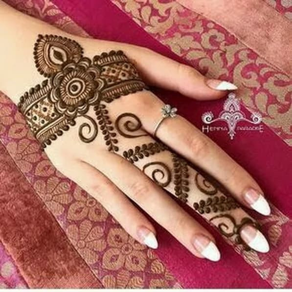 adorable new year  backhand mehndi designs ideas