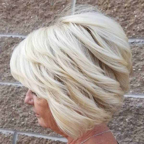 Medium Blonde Balayage Hairstyle with Dynamic Layers Hairstyles for Older Women