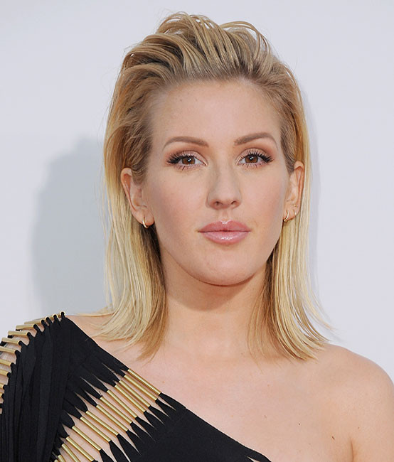 Slicked-Back Medium Length Hairstyle for Women
