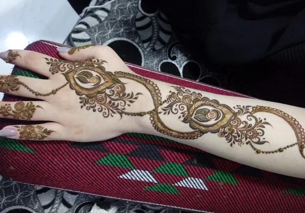 backhand with arms mehndi designs