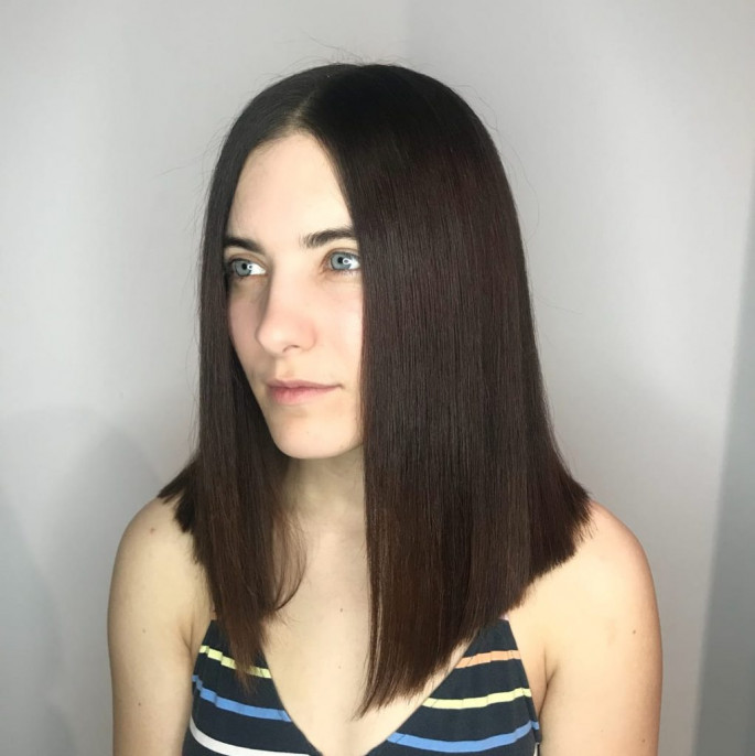 Sleek Center Part Medium Length Hairstyle for Women